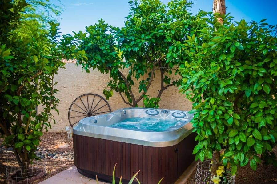 Outdoor hot tub set up surrounded by trees