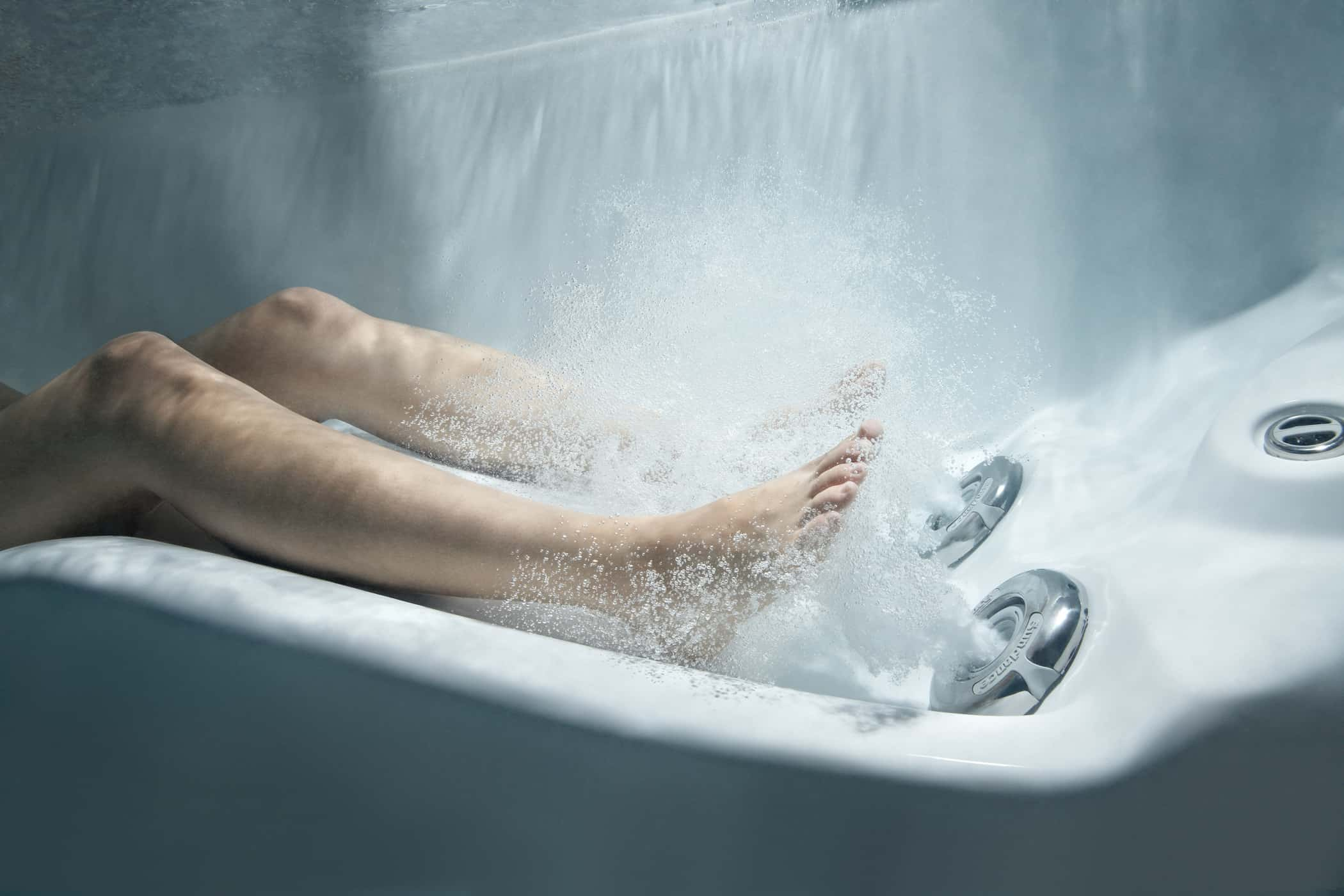 Person engaging in hot tub reflexology