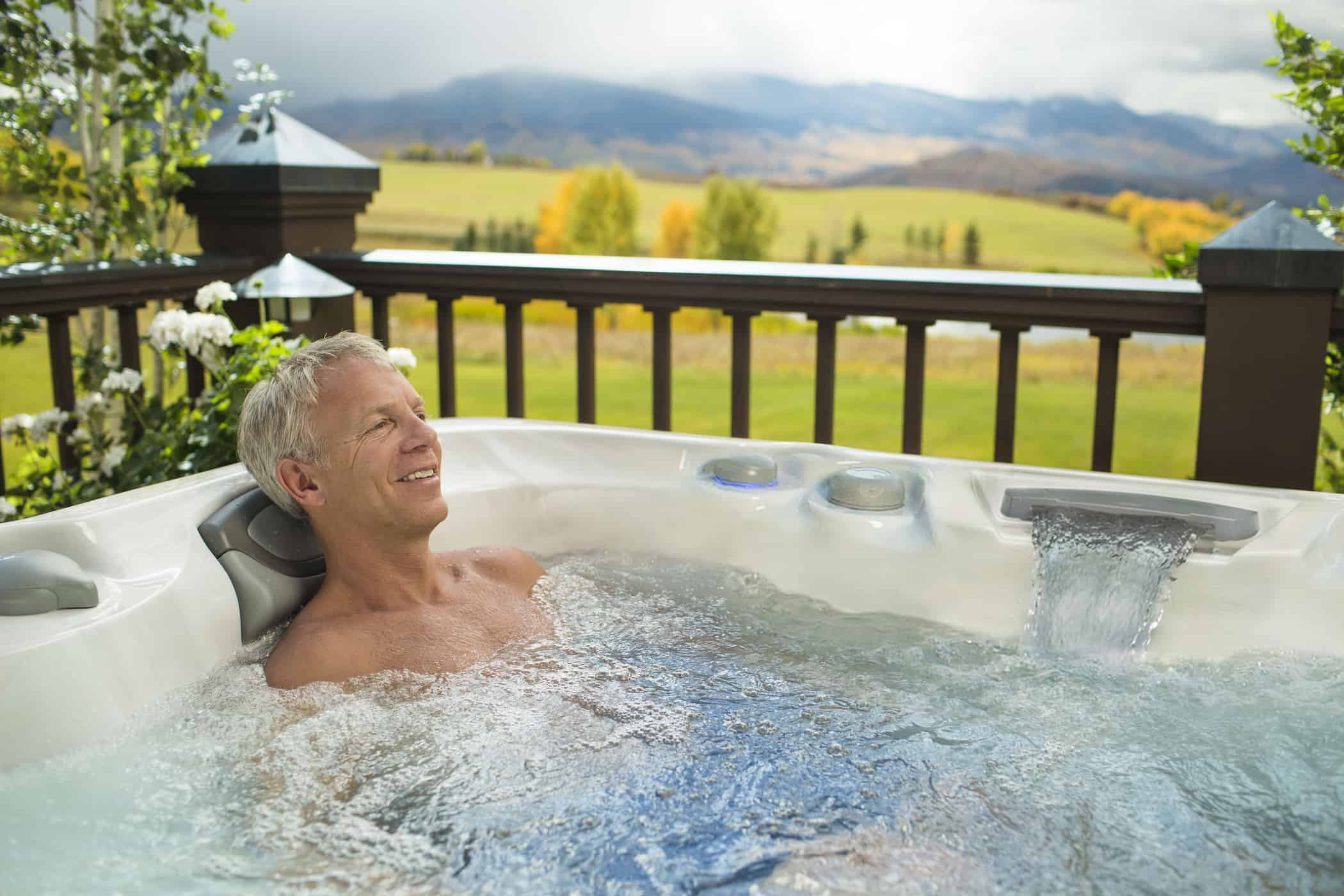Man relaxing in hot tub.
